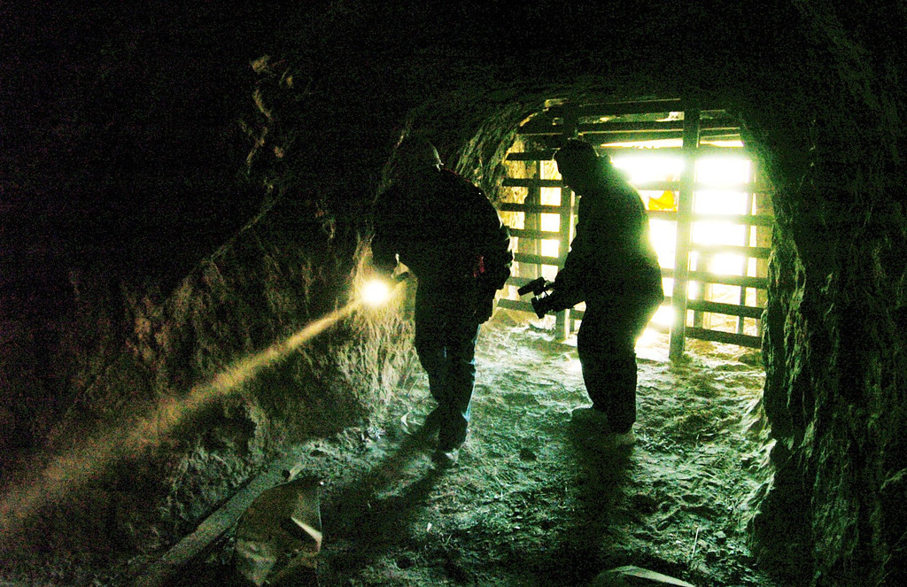 ". Members of the media are silhouetted against the entrance to the abandoned Tesla sand mine in the Carnegie State Vehicular Recreational Area, 12 miles southeast of Livermore, on Wednesday, January 16, 2008. Media were invited to a press conference at the mine today, as the Department of Conservation\'s Office of Mine Reclamation is permanently sealing the Tesla sand mine as part of a statewide effort to seal mine sites that are hazardous to the public. Every year people are injured or killed at one of the approximately 47,000 abandoned mines in the state of California. The Abandoned Mine Lands Unit of the California Department of Conservation participates in the national ""Stay Out, Stay Alive\"" public awareness campaign aimed at warning children and adults about the dangers of exploring or playing near abandoned mines.
