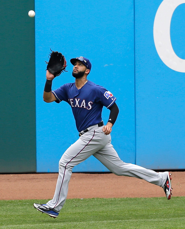 . Texas Rangers\' Nomar Mazara catches a ball hit by Cleveland Indians\' Jason Kipnis in the fifth inning of a baseball game, Thursday, June 29, 2017, in Cleveland. (AP Photo/Tony Dejak)