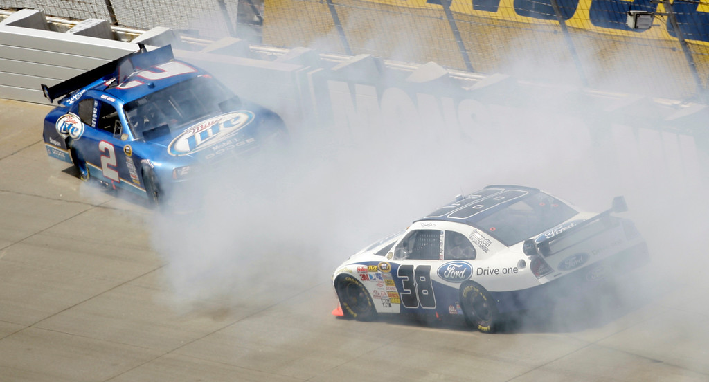 . ** FILE ** In this Sept. 21, 2008, file photo, Kurt Busch, left, crashes in turn one near David Gilliland, right, during the NASCAR Camping World RV 400 Sprint Cup Series auto race at Dover International Speedway in Dover, Del. Neither Busch nor Ryan Newman came close to making the 12-man field for the Chase for the championship. Stock car rookie Sam Hornish Jr., a three-time open-wheel champion who gave Roger Penske one of those Indy wins, kept slipping on NASCAR\'s learning curve. Newman has moved to Tony Stewart\'s new Stewart-Haas racing operation. (AP Photo/Carolyn Kaster, File)