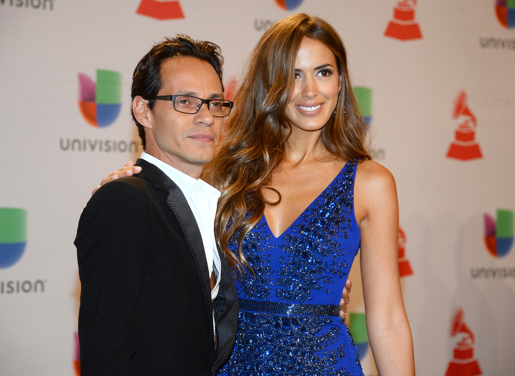 . Marc Anthony, left, and his wife Shannon De Lima arrive at the 15th annual Latin Grammy Awards at the MGM Grand Garden Arena on Thursday, Nov. 20, 2014, in Las Vegas. (Photo by Al Powers/Invision/AP)
