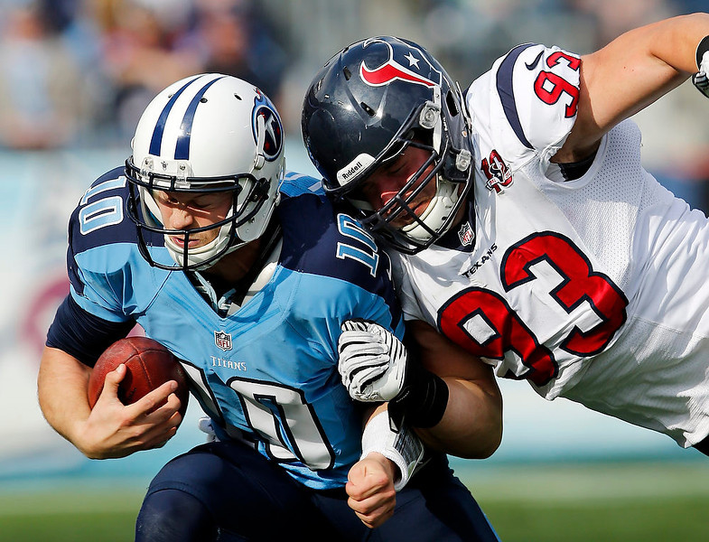 . Tennessee Titans quarterback Jake Locker (10) is hit by Houston Texans defensive end Jared Crick (93) in the second quarter of an NFL football game on Sunday, Dec. 2, 2012, in Nashville, Tenn. (AP Photo/Joe Howell)