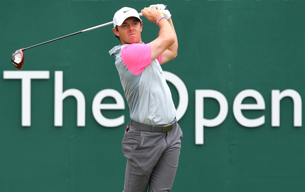 . Northern Ireland\'s Rory McIlroy watches his shot from the 1st tee during his fourth round, on the final day of the 2014 British Open Golf Championship at Royal Liverpool Golf Course in Hoylake, north west England on July 20, 2014. Rory McIlroy took a six strokes lead into the final round of the British Open on Sunday knowing that a win at the end of the day would put him up alongside Tiger Woods and Jack Nicklaus in major golf history. PETER MUHLY/AFP/Getty Images