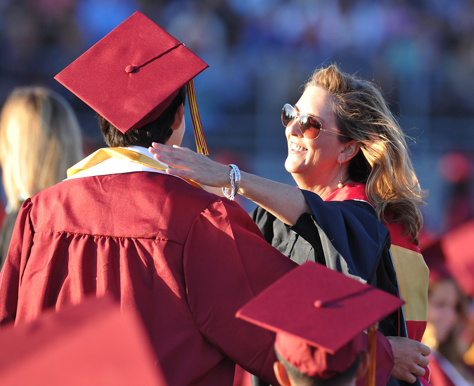 . Principal Ann Fitzgerald gives hugs to the graduates during La Serna High School\'s 51st Annual Commencement at La Mirada High School stadium in La Mirada on Thursday June 13, 2013. La Serna marked the commencement of 635 graduates and marking Principal Ann Fitzgerald\'s first graduation as principal. (SGVN/Staff Photo by Keith Durflinger)
