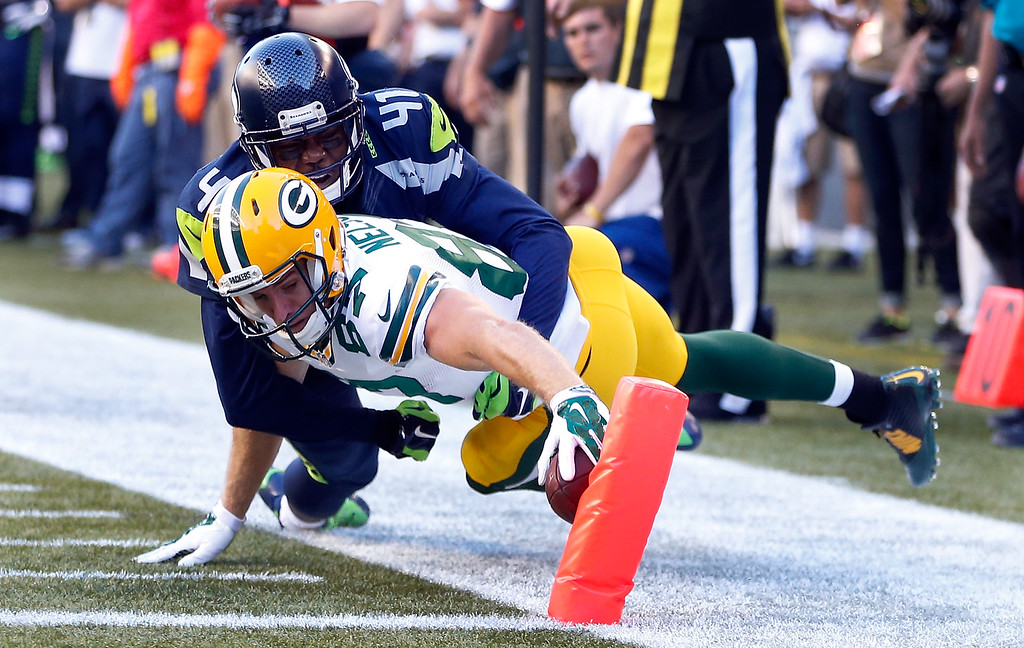 . SEATTLE, WA - SEPTEMBER 04: Wide receiver Jordy Nelson #87 of the Green Bay Packers stretches unsuccessfully for the end zone as cornerback Byron Maxwell #41 of the Seattle Seahawks tries to tackle him during the first quarter of the game at CenturyLink Field on September 4, 2014 in Seattle, Washington.  (Photo by Otto Greule Jr/Getty Images)