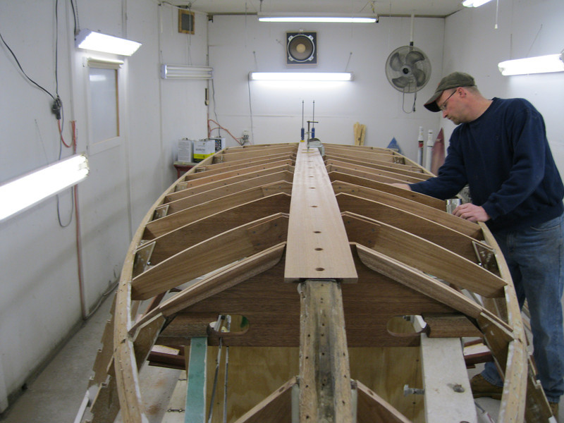 Front view of new keel installed and new frames being coated with epoxy.