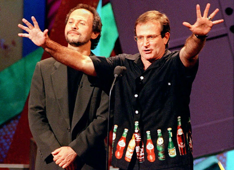 ". Comedians Billy Crystal (L) and Robin Williams host HBO\'s ""Comic Relief VII\"" to raise money for the nation\'s homeless 11 November in Universal City, California.   Also hosting the show was comedian Whoopi Goldberg.  DAN GROSHONG/AFP/Getty Images"