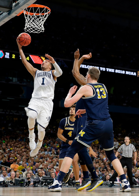 . Villanova\'s Jalen Brunson (1) goes up for a lay up during the first half in the championship game of the Final Four NCAA college basketball tournament against Michigan, Monday, April 2, 2018, in San Antonio. (AP Photo/Eric Gay)