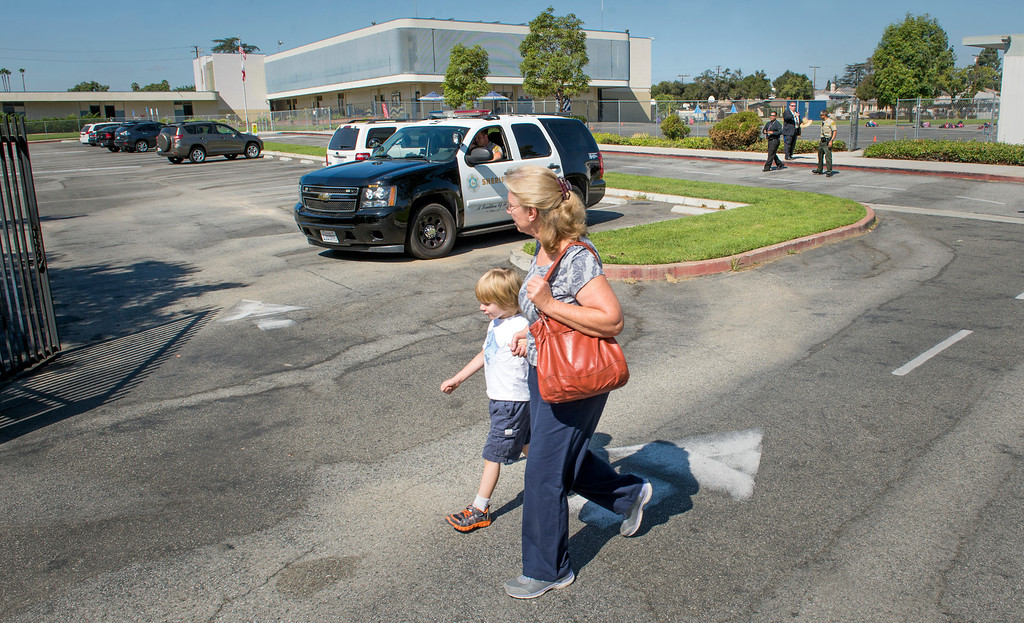 . An afternoon kindergartener and parent arrives and leaves not knowing that school was canceled after a bomb threat at Longden Elementary School in Temple City, Calif. Sept. 25, 2013.  (Staff photo by Leo Jarzomb/San Gabriel Valley Tribune)