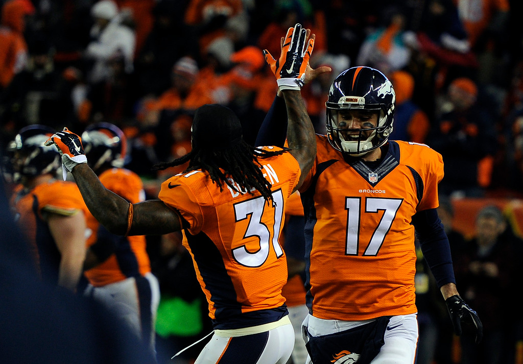 . DENVER, CO - DECEMBER 28: Brock Osweiler (17) of the Denver Broncos celebrates first career touchdown with Omar Bolden. The Broncos The Denver Broncos played the Oakland Raiders at Sports Authority Field at Mile High in Denver on December, 28 2014. (Photo by Tim Rasmussen/The Denver Post)