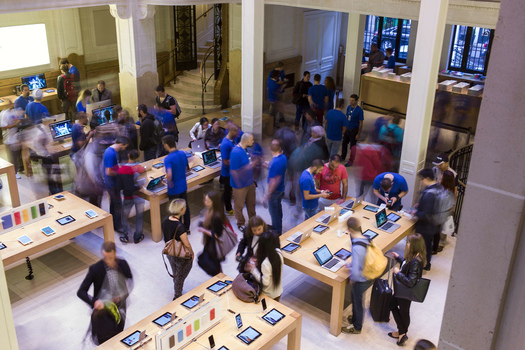 . People check items at the Apple Store in Paris on the day of the launch of the latest iPhone, the iPhone 6, on September 19, 2014. Apple says more than four million pre-orders were received in the 24 hours after the sale was announced. AFP PHOTO / FRED DUFOUR/AFP/Getty Images