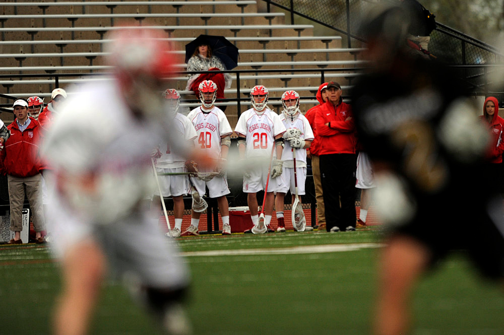 . Players from Regis Jesuit High School look on during a CHSAA 5A boys lacrosse semifinal game against Arapahoe on May 15, 2013, in Denver, Colorado. Arapahoe won 13-5 to advance to the finals. (Photo by Daniel Petty/The Denver Post)