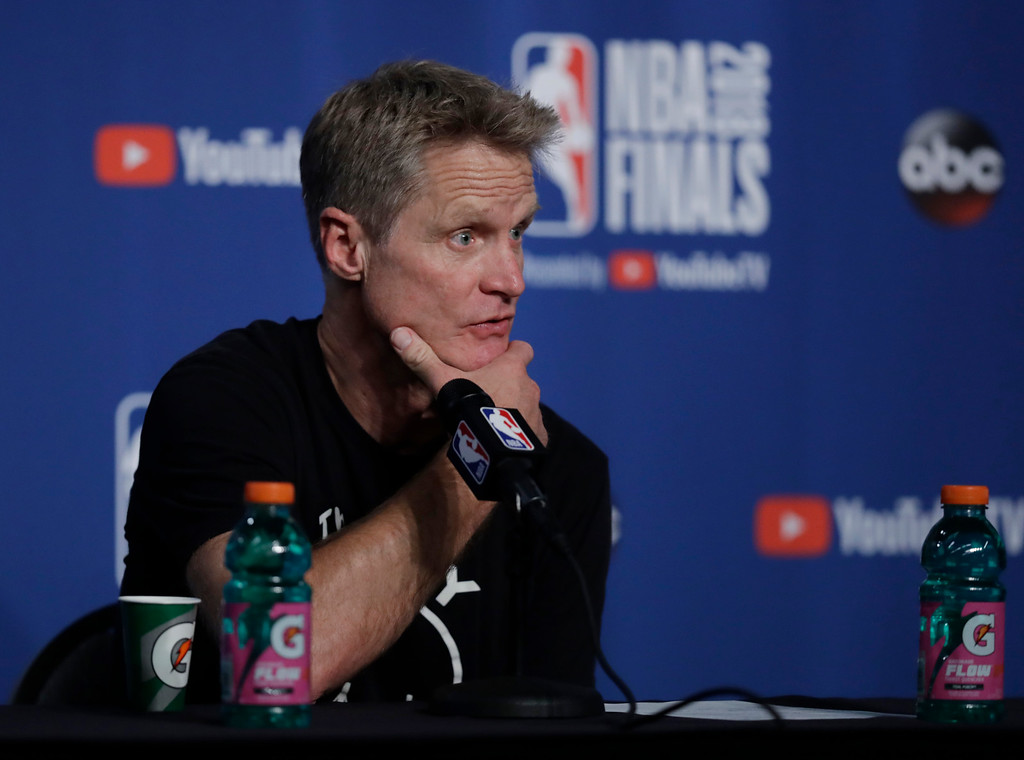 . Golden State Warriors coach Steve Kerr speaks during a news conference following Game 3 of basketball\'s NBA Finals, Wednesday, June 6, 2018, in Cleveland. The Warriors defeated the Cleveland Cavaliers 110-102 to take a 3-0 lead in the series. (AP Photo/Tony Dejak)