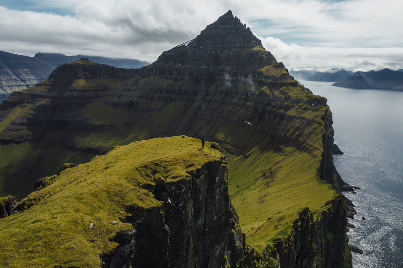 On top of mount Borgarin, facing the highest mountain Nestindar on Kalsoy Island