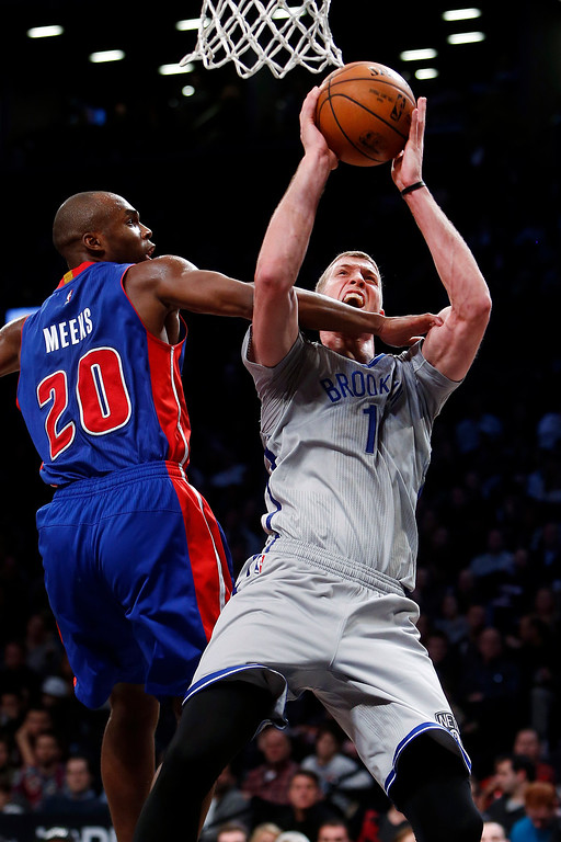 . Brooklyn Nets\' Mason Plumlee (1) goes to the basket against Detroit Pistons\' Jodie Meeks (20) during the fourth quarter of an NBA basketball game Sunday, Dec. 21, 2014, in New York.  Brooklyn beat Detroit 110-105. (AP Photo/Jason DeCrow)