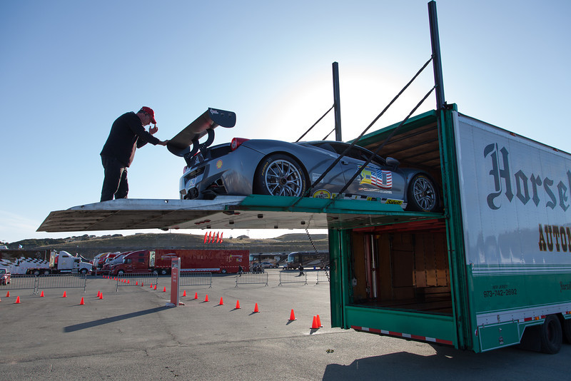 Early morning and cars are being unloaded at Laguna Seca. © 2014 Victor Varela
