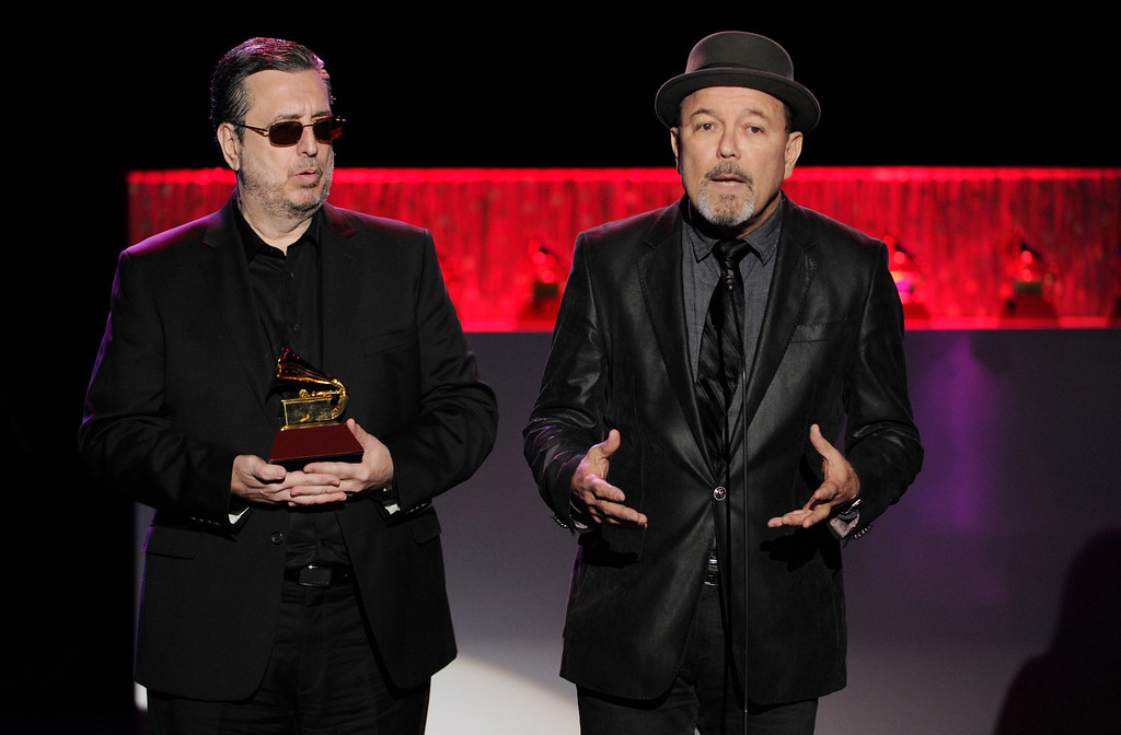 """. Ruben Blades, right, accepts the award for best tango album for \""""Tangos\"""" on stage at the 15th annual Latin Grammy Awards at the MGM Grand Garden Arena on Thursday, Nov. 20, 2014, in Las Vegas. Looking on from left is Carlos Franzetti. (Photo by Chris Pizzello/Invision/AP)"""