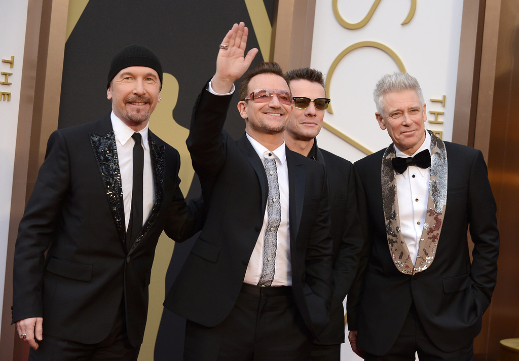 . The Edge, from left, Bono, Larry Mullen, Jr., and Adam Clayton of U2 arrive at the Oscars on Sunday, March 2, 2014, at the Dolby Theatre in Los Angeles.  (Photo by Jordan Strauss/Invision/AP)