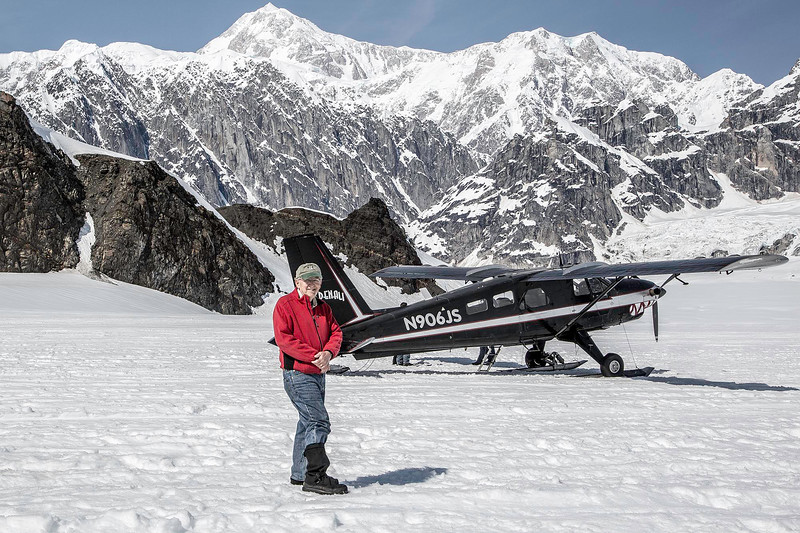 Keith Carver on Ruth Glacier, with deHaviland Beaver, and Mt. McKinley (over my heard)