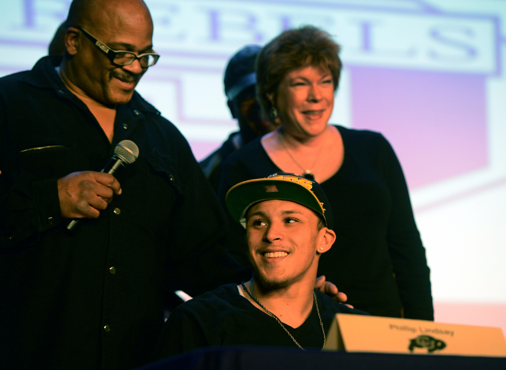 . Denver South High School football coach Tony Lindsay Sr. introduces player Phillip Lindsay and his parents, Diane and Troy, during a signing day ceremony at the school in Denver, CO February  06, 2013. Phillip Lindsay signed with the University of Colorado. (Photo By Craig F. Walker/The Denver Post)