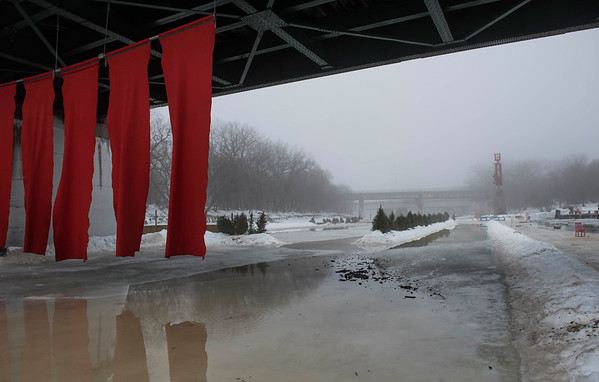 DAVID LIPNOWSKI / WINNIPEG FREE PRESS   Abnormally warm weather has closed the Red River Mutual Trail and the skating rink at The Forks Sunday January 22, 2017.