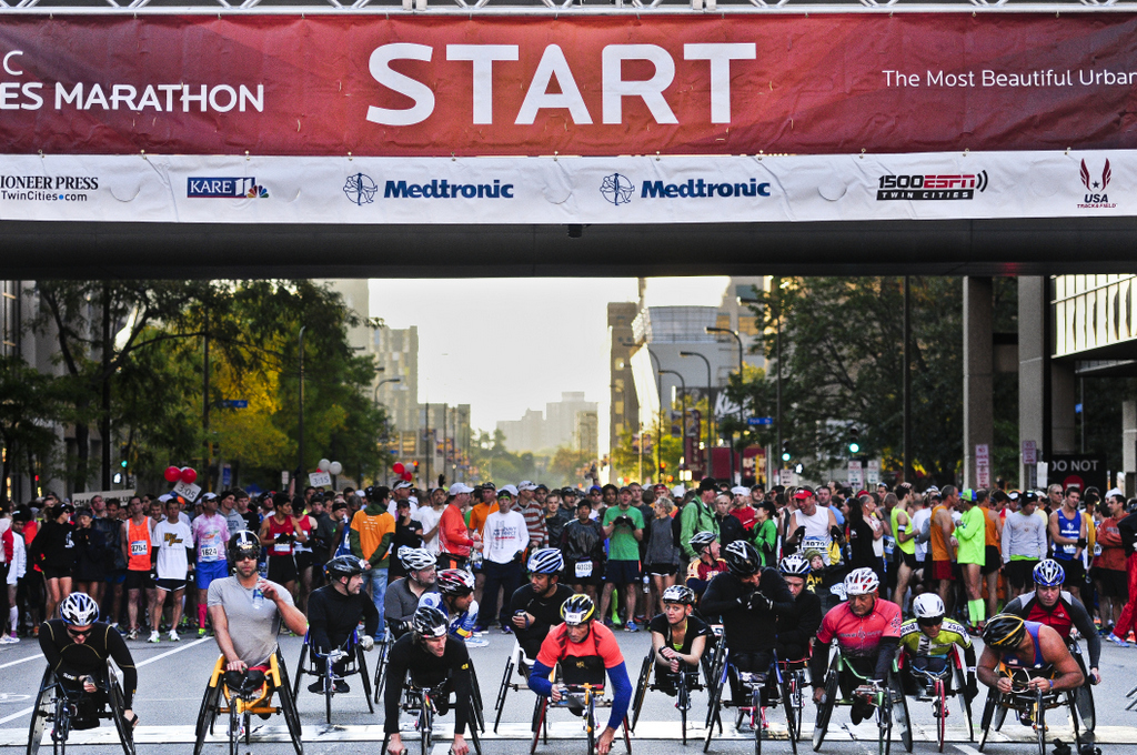 . Wheelchair athletes and runners gather at the start line just before the beginning of the 2013 Twin Cities Marathon in downtown Minneapolis. Known as the most beautiful urban marathon in America, the race started near the Metrodome in Minneapolis and ended at the Minnesota State Capitol in St. Paul. (Pioneer Press: Simon Guerra)