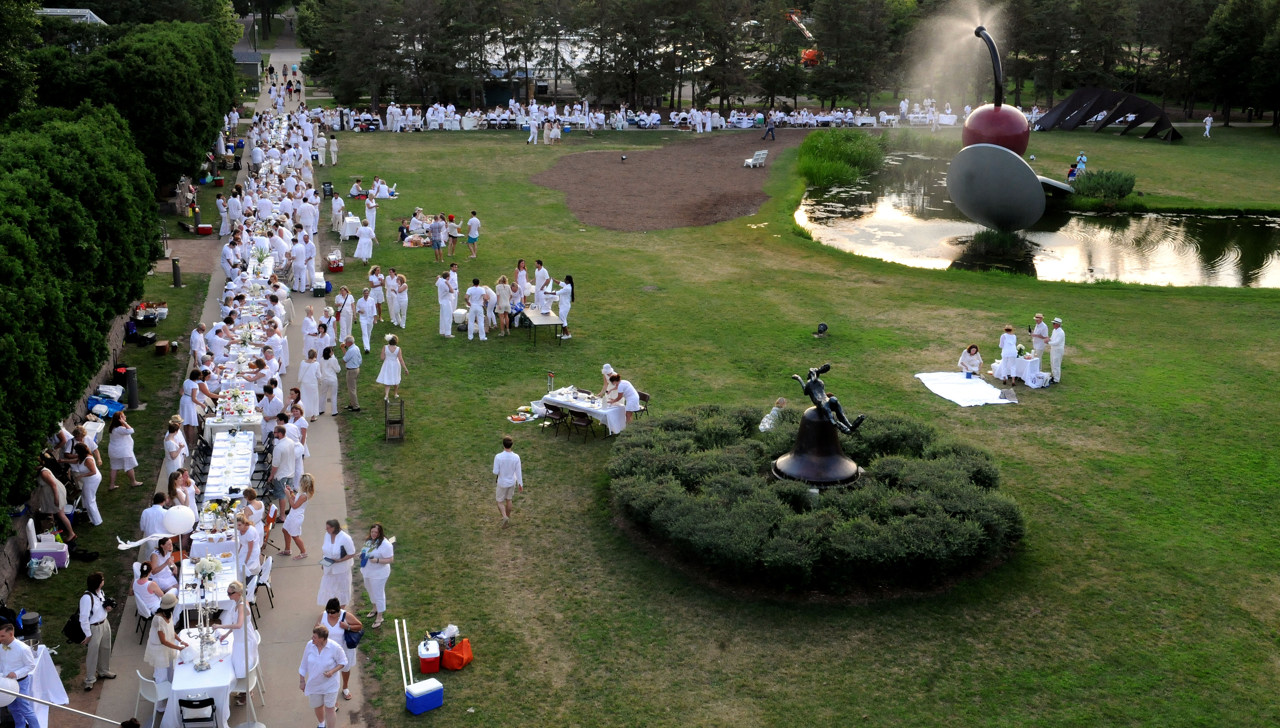 . A line of tables in white are prepared for fine dining on the edges of the Minneapolis Sculpture Park for Dinner in White. (Pioneer Press: Sherri LaRose-Chiglo)