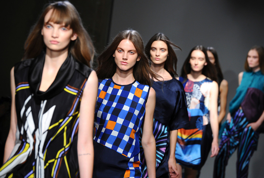 . Models wear creations by Japanese fashion designer Atsuro Tayama\'s ready-to-wear Spring/Summer 2014 fashion collection presented in Paris, Wednesday, Sept.25, 2013. (AP Photo/Zacharie Scheurer)