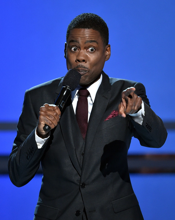 . Host Chris Rock speaks onstage during the BET AWARDS \'14 at Nokia Theatre L.A. LIVE on June 29, 2014 in Los Angeles, California.  (Photo by Kevin Winter/Getty Images for BET)