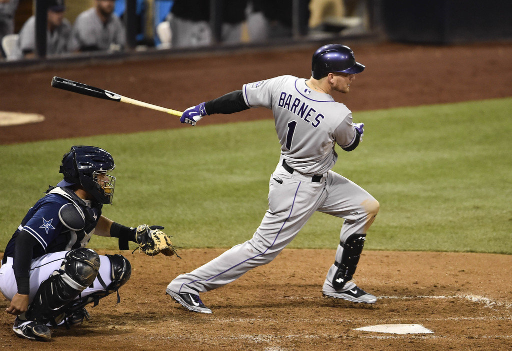 . SAN DIEGO, CA - SEPTEMBER 23:  Brandon Barnes #1 of the Colorado Rockies hits a single during the ninth inning of a baseball game against the San Diego Padres at Petco Park September, 23, 2014 in San Diego, California.  (Photo by Denis Poroy/Getty Images)