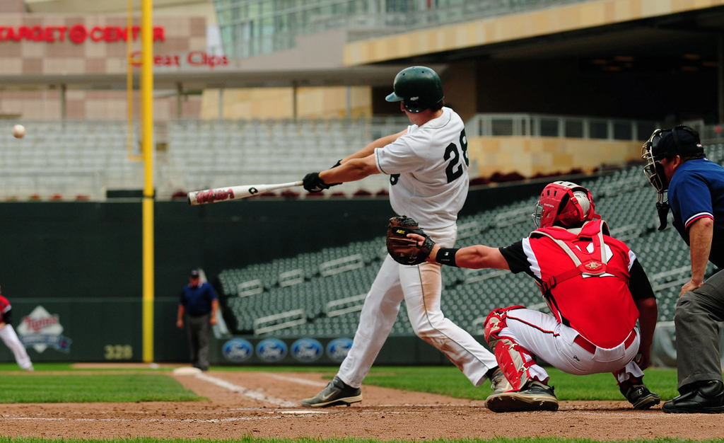 . Mounds View designated hitter Charlie Callahan drives in two runs with a single to the right-center gap during the Mustangs\' four-run fourth inning against Rocori.  (Pioneer Press: Scott Takushi)