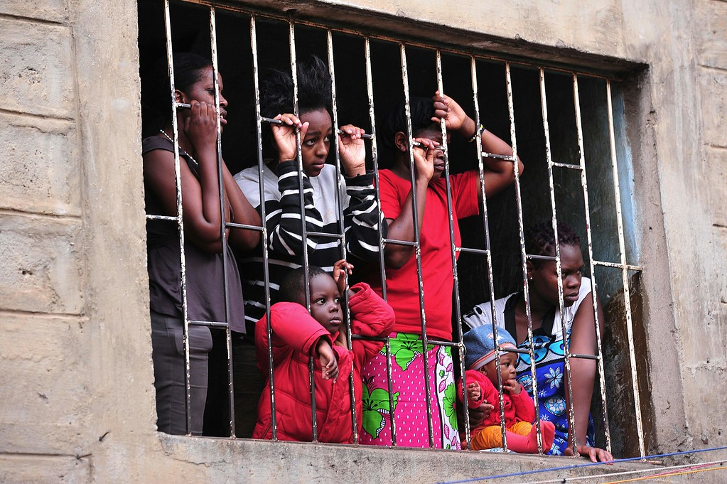 . Neighbours observe the rescue efforts after a building collapsed in Nairobi on April 30, 2016.  / AFP PHOTO / SIMON MAINA/AFP/Getty Images