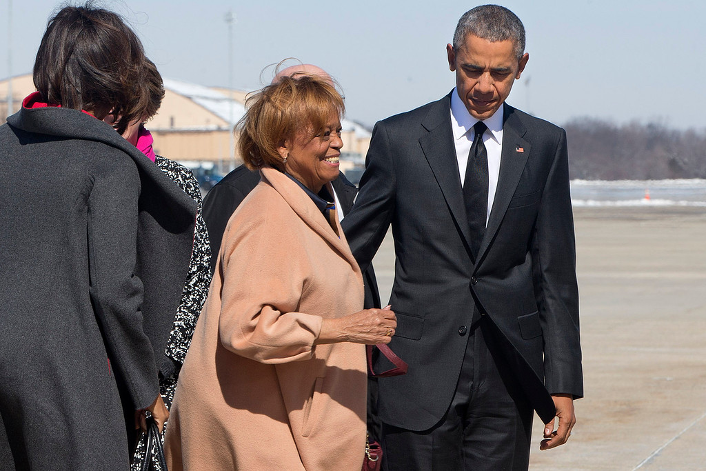 ". Marian Robinson, mother of first lady Michelle Obama, left, smiles as she boards Air Force One with President Barack Obama en route to the commemoration of the 50th anniversary of ìBloody Sunday,"" a landmark event of the civil rights movement, from Andrews Air Force Base, Md. Saturday, March 7, 2015. On the 50th Anniversary of the Selma to Montgomery march, \""Bloody Sunday\"" refers to the day in 1965 when police attacked marchers demonstrating for voting rights. (AP Photo/Jacquelyn Martin)"