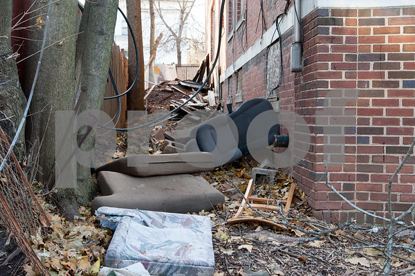 12/06/17 Wesley Bunnell   Staff Trash and other items on the side of 24 Tremont St in the North Oak Section of New Britain. Residents of the neighborhood have recently been speaking up regarding blight and alleged neglect from the city regarding their concerns.