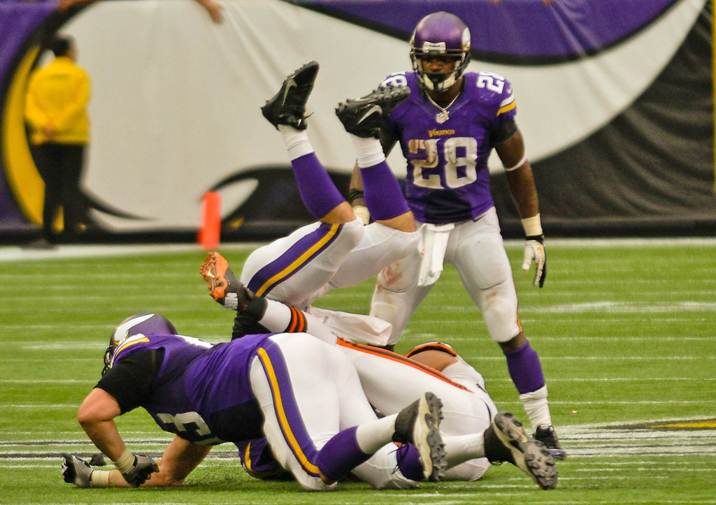 . Vikings quarterback Christian Ponder is sacked in front of running back Adrian Peterson on the final play of Minnesota\'s 31-27 loss to the Browns. In the foreground is Vikings guard Brandon Fusco.   (Pioneer Press: Ben Garvin)