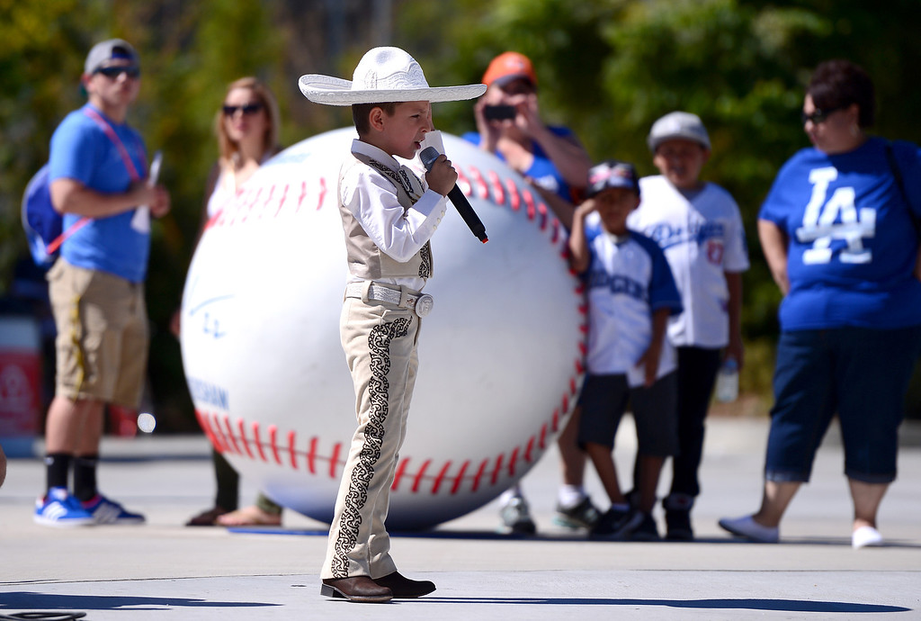 . Emilio Ortego, 8, of La Puente, sings with Mariachi Palomar outside the reserved gate at Dodger Stadium before the final game of the regular season Sunday, September 29, 2013. (Photo by Sarah Reingewirtz/Pasadena Star-News)