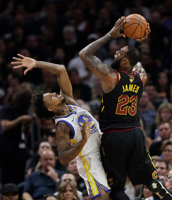 . Cleveland Cavaliers\' LeBron James shoots over Golden State Warriors\' Nick Young during the first half of Game 4 of basketball\'s NBA Finals, Friday, June 8, 2018, in Cleveland. (AP Photo/Tony Dejak)
