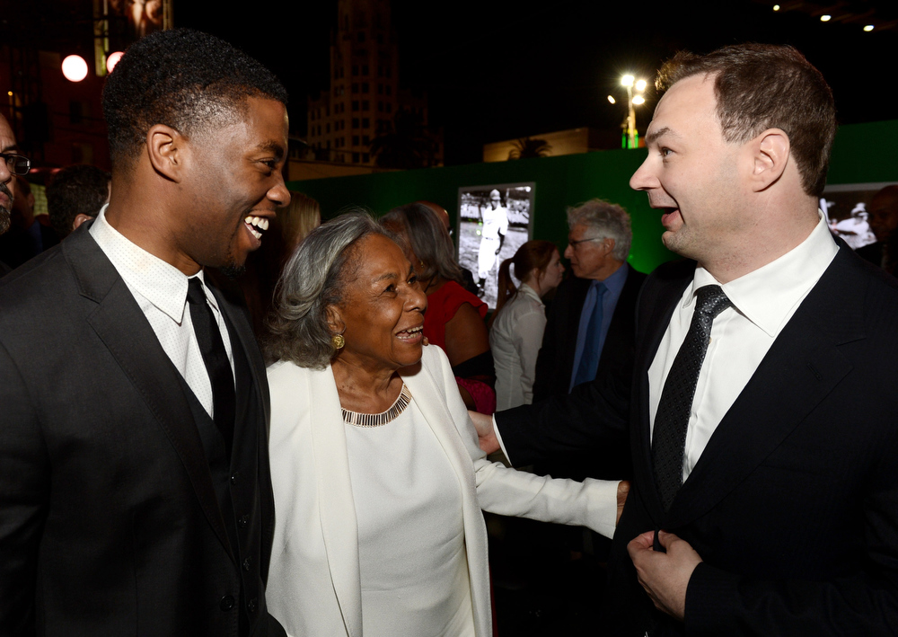 ". Actor Chadwick Boseman, Jackie Robinson\'s widow Rachel Robinson and producer Thomas Tull pose at the after party for the premiere of Warner Bros. Pictures\' and Legendary Pictures\' ""42\"" at the Chinese Theatre on April 9, 2013 in Los Angeles, California.  (Photo by Kevin Winter/Getty Images)"