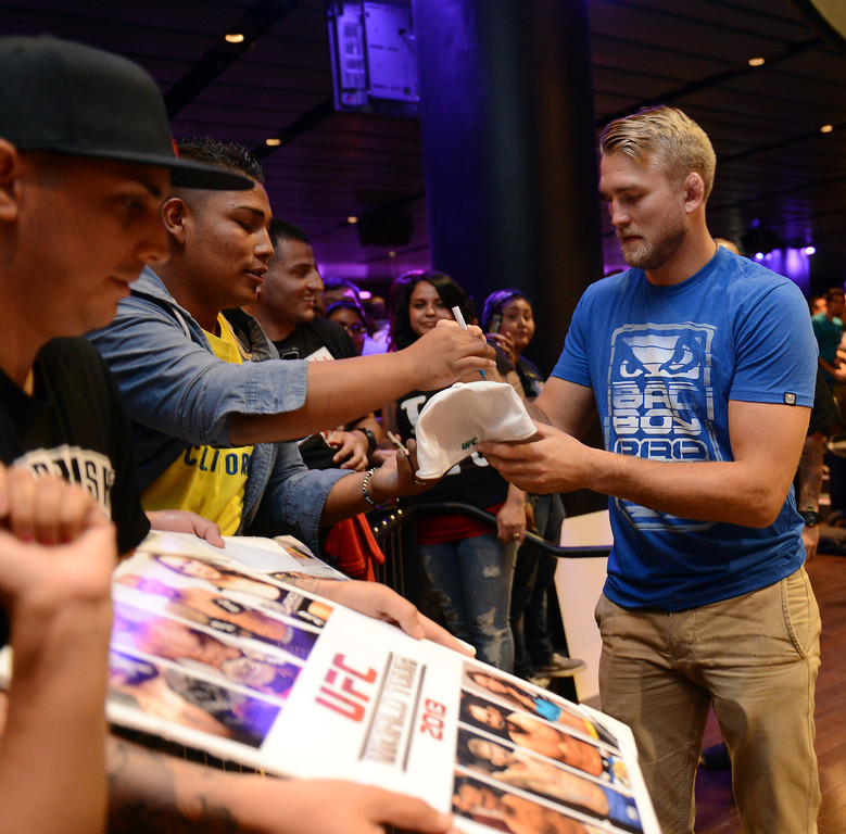 . UFC fighter Alexander Gustafsson signs autographs during the UFC World Tour at Club Nokia Tuesday, July 30, 2013 in Los Angeles. (Hans Gutknecht/Los Angeles Daily News)