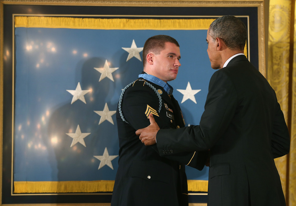 . U.S. President Barack Obama (R) awards the Medal of Honor to U.S. Army Sgt. Kyle J. White during a ceremony in the East Room of the White House May 13, 2014 in Washington, DC.  (Photo by Mark Wilson/Getty Images)