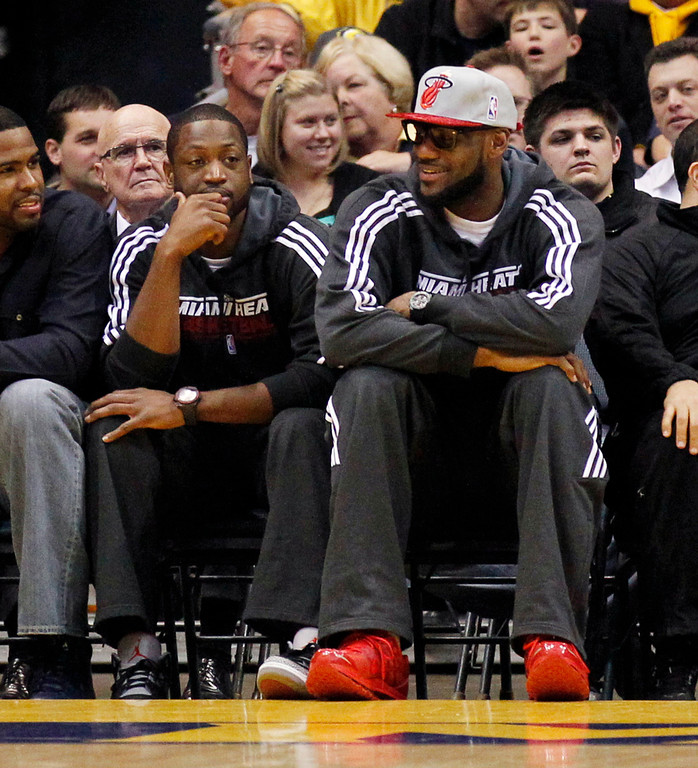 . Miami Heat\'s Lebron James, right, and Dwyane Wade attend an NCAA college basketball game between Marquette and Seton Hall, Tuesday, Jan. 31, 2012, in Milwaukee. (AP Photo/Jeffrey Phelps)