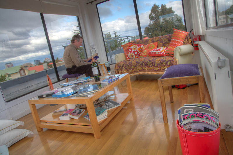 Hotel Ilaia has a welcoming sun room high above the rooftops of Punta Arenas, Chile. (HDR)