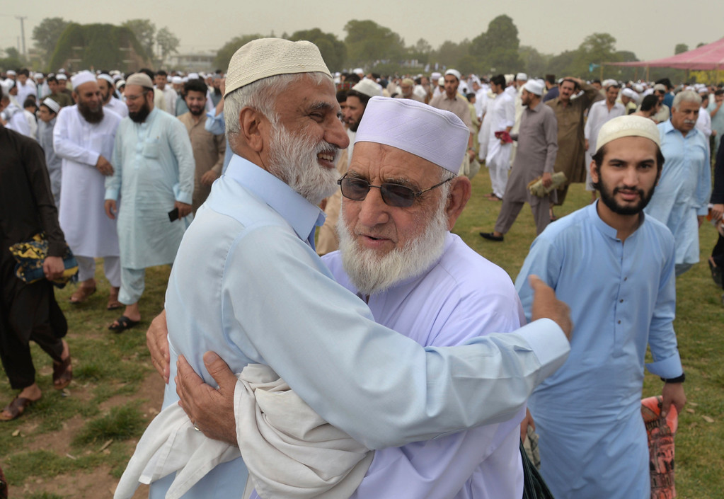 . Pakistani faithful greet each others after offering the Eid al-Fitr prayers to celebrate the end of the holy month of Ramadan in Peshawar, Pakistan, Friday, June 15, 2018. Eid al-Fitr is being celebrated in parts of Khyber-Pakhtunkhwa province on Friday while rest of Pakistan will begin the festivities on Saturday. (AP Photo/Muhammad Sajjad)