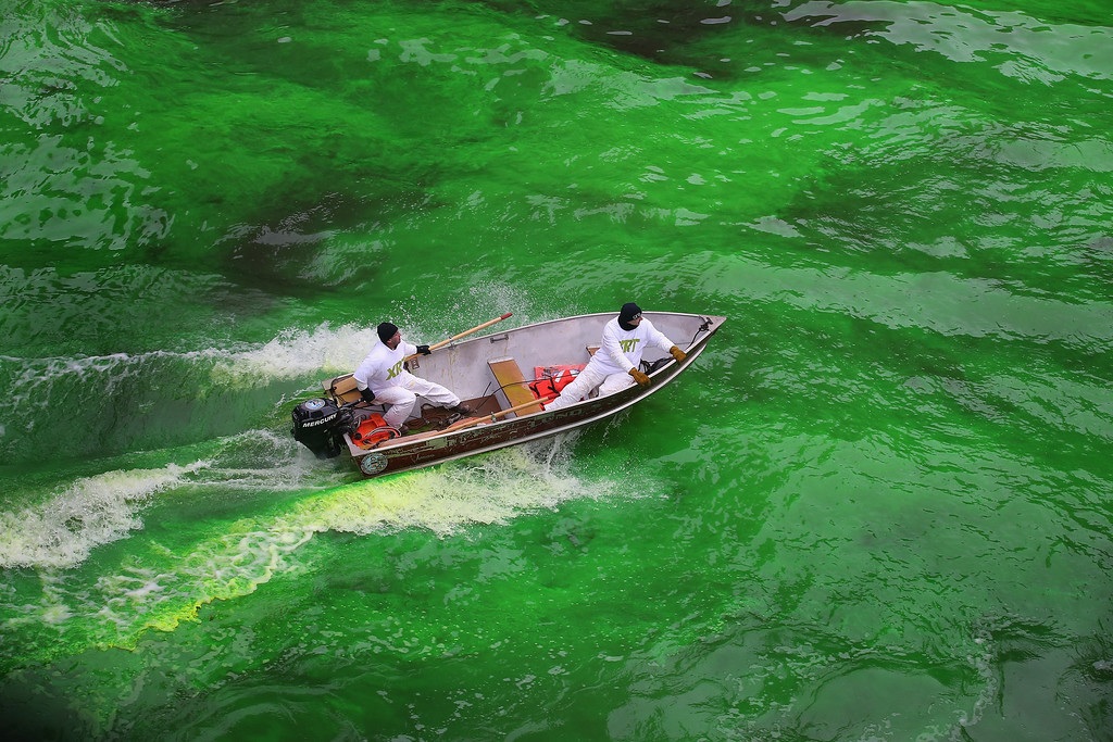 . Workers help to dye the Chicago River green to kick off the city\'s St. Patrick\'s day celebration on March 16, 2013 in Chicago, Illinois. The dying of the river has been a tradition in the city for 43 years.  (Photo by Scott Olson/Getty Images)