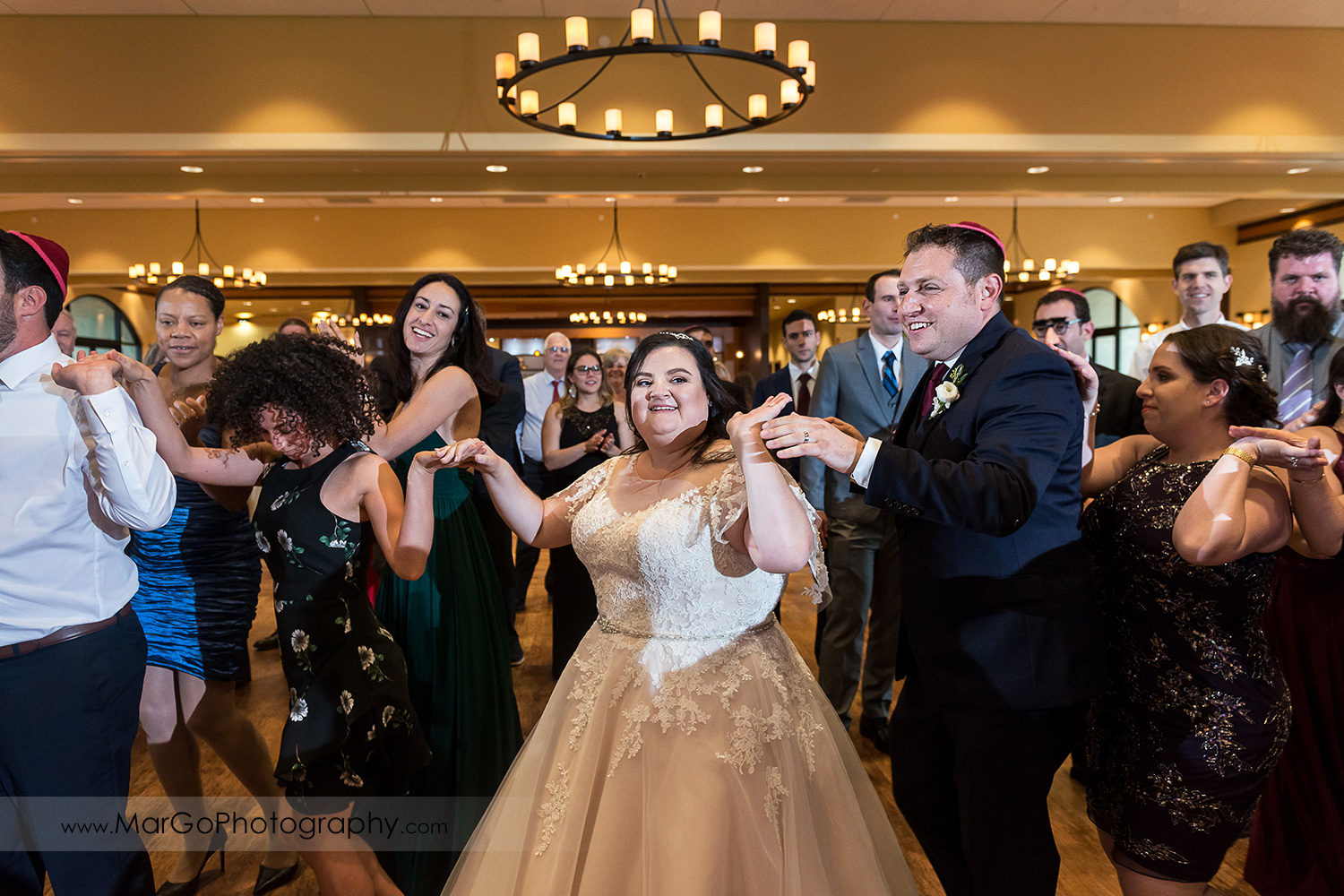 jewish bride and groom during horah dance at Livermore Garre Vineyard and Winery