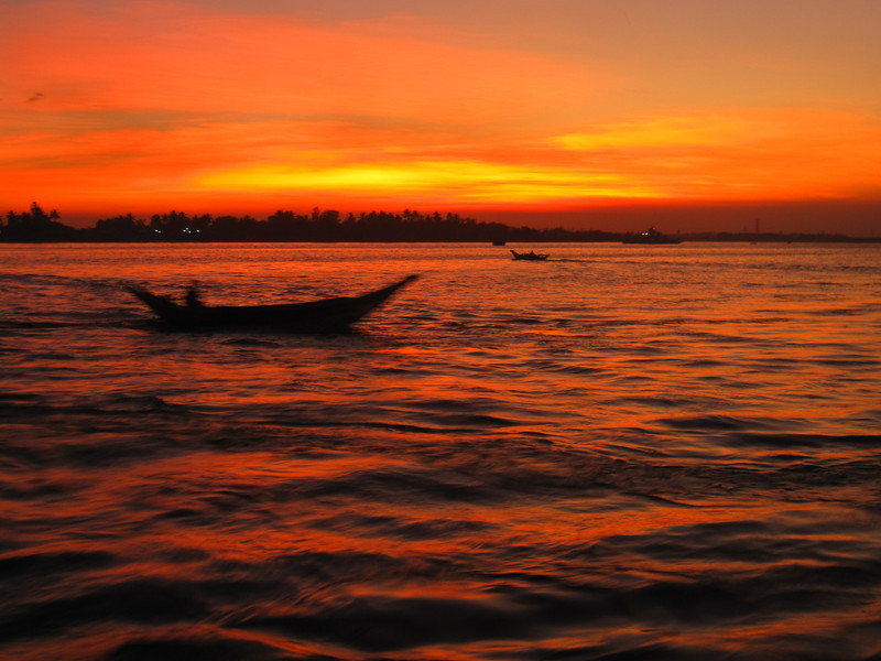 Boats at sunset in Yangon, Myanmar (Burma)