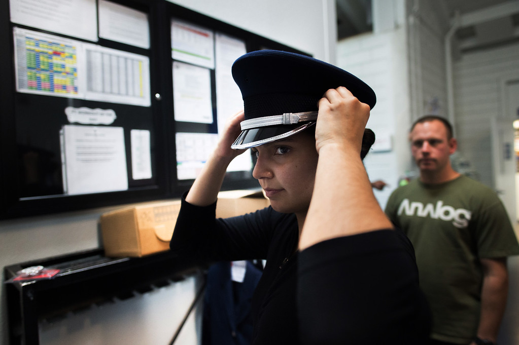 . Staff Sgt. Anahi Ledezma tries on her ceremonial service hat at March Air Reserve Base in Riverside, Calif. on Tuesday, May 12, 2015. (Photo by Watchara Phomicinda/ Los Angeles Daily News)