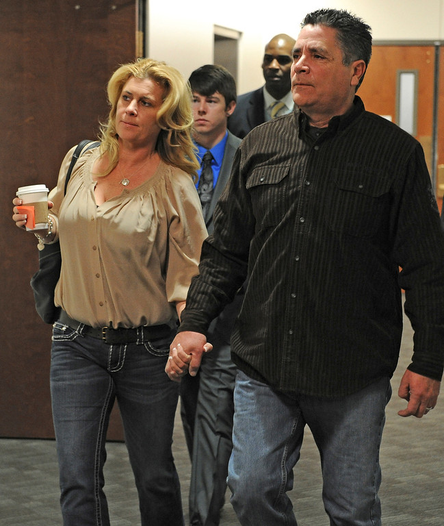 ". CENTENNIAL, CO - JANUARY 11: Steve Hernandez, father of slain victim Rebecca Wingo enter the second floor of the Arapahoe County Courthouse, Friday, January 11, 2013 on their way to the courtroom. In court Hernandez shouted out ""rot in hell, Holmes.\"" The  arraignment for Aurora theater shooting suspect James Holmes  was postponed until March 2013 for the July 20 shooting at the Century 16 theater that killed 12 people and injured 70 others. (Photo By Tim Rasmussen/The Denver Post)"