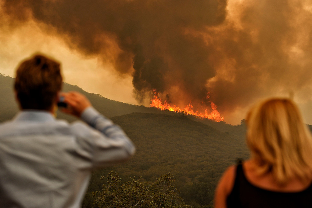 . Residents watch the flames of the Springs Fire move closer to their homes along W Potrero Rd in Thousand Oaks Friday, May 3, 2013. (Hans Gutknecht/LA Daily News)