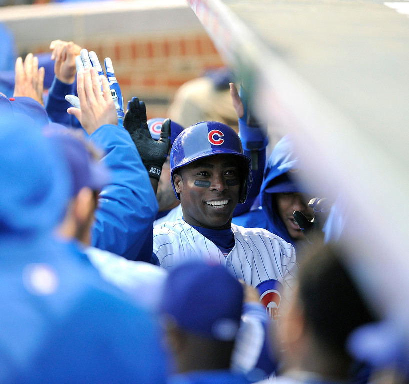 . Chicago Cubs\' Alfonso Soriano is congratulated by teammates after his two-run home run against the Colorado Rockies during the first inning of a baseball game Monday, May 13, 2013, in Chicago. (AP Photo/Jim Prisching)