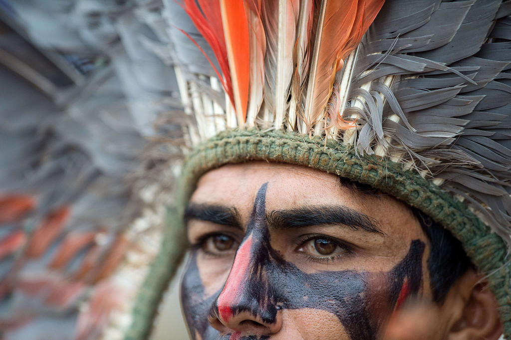 . A Brazilian indigenous man of the Terena tribe observes the bow and arrow competition during the XII International Games of Indigenous Peoples in Cuiaba, Mato Grosso state, Brazil on November 12, 2013.  AFP PHOTO / Christophe SIMON/AFP/Getty Images